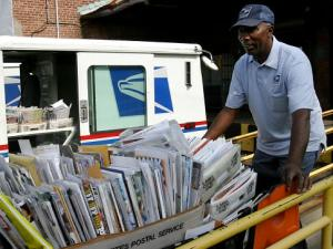 Stanley Madison, an employee of the United States Postal Service for 40 years, loading his truck with mail in Manhasset, (http://www.noomizo.com/index.php/the-postal-regulatory-commission-postal-service-operations/us-postal_service/)