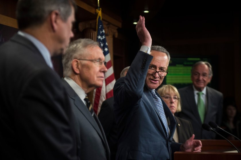Senator Charles E. Schumer, center, with Senator Harry Reid, second from left, spoke Wednesday about the minimum wage bill. Credit Gabriella Demczuk/The New York Times