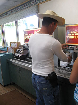A man openly carrying a handgun at a Burger King in Eagle, Colorado. (http://en.wikipedia.org/wiki/Open_carry_in_the_United_States)
