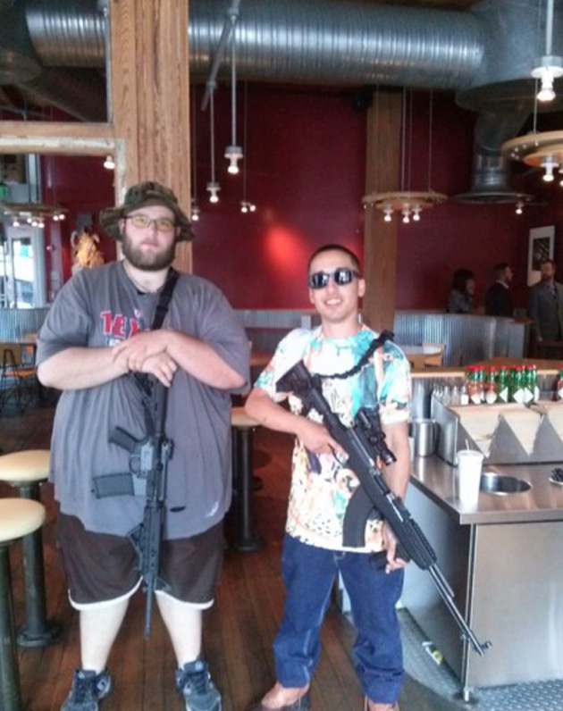 Open Carry Texas demonstrators at Chipotle. Screenshot: Facebook (Source http://www.motherjones.com/politics/2014/05/chipotle-guns-open-carry-texas)